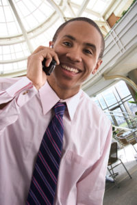 Black Youth Businessman on Phone Smiling iStock_000001079159_Large